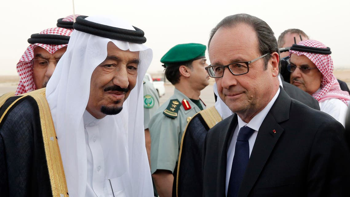 French President Francois Hollande, right, is greeted by Saudi Arabia's King Salman upon his arrival at Riyadh airport, Saudi Arabia, Monday, May 4, 2015. Hollande is the guest of honor of the Gulf cooperation council summit in Riyadh, where security issues in the region are going to be discussed. (AP Photo/Christophe Ena, Pool)