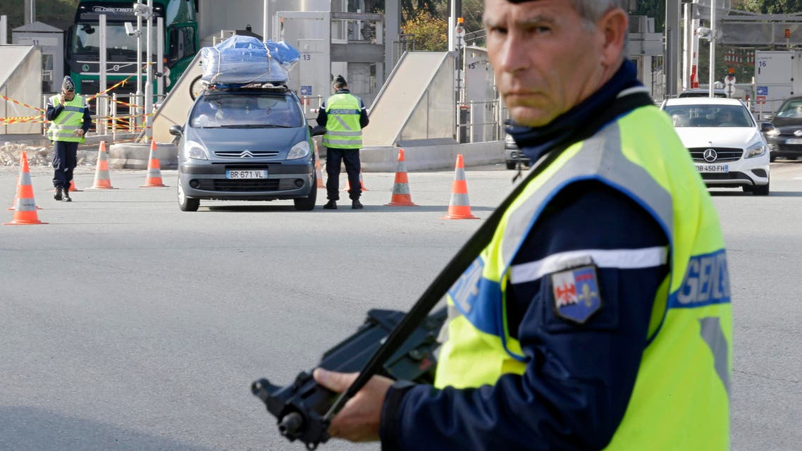 French police check vehicles at the France Italy border in La Turbie, southeastern France, Saturday, Nov. 14, 2015. (Reuters)
