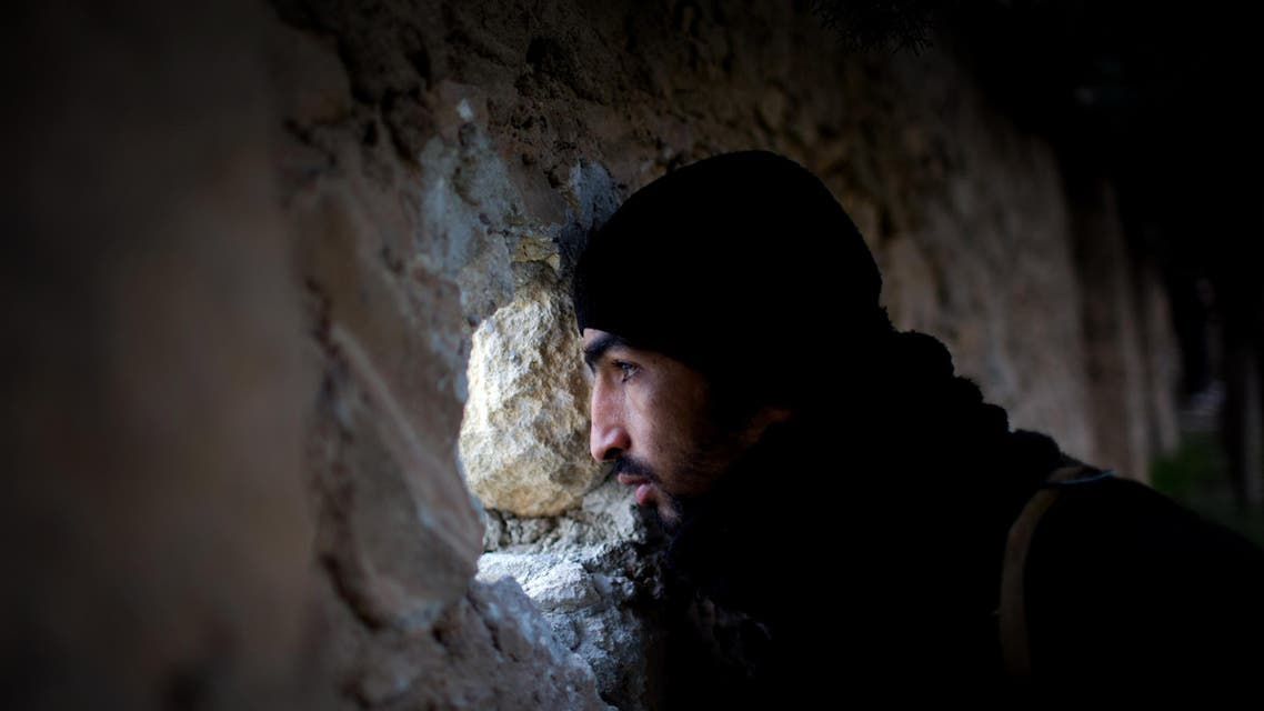 FSA fighter scans for Syrian Army positions during an attack towards a Military Academy in Tal Sheer village, north of Aleppo province, Syria, Thursday, Dec 13, 2012 (AP Photo / Manu Brabo)