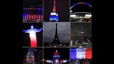 Monuments light up red, blue and white in solidarity with France