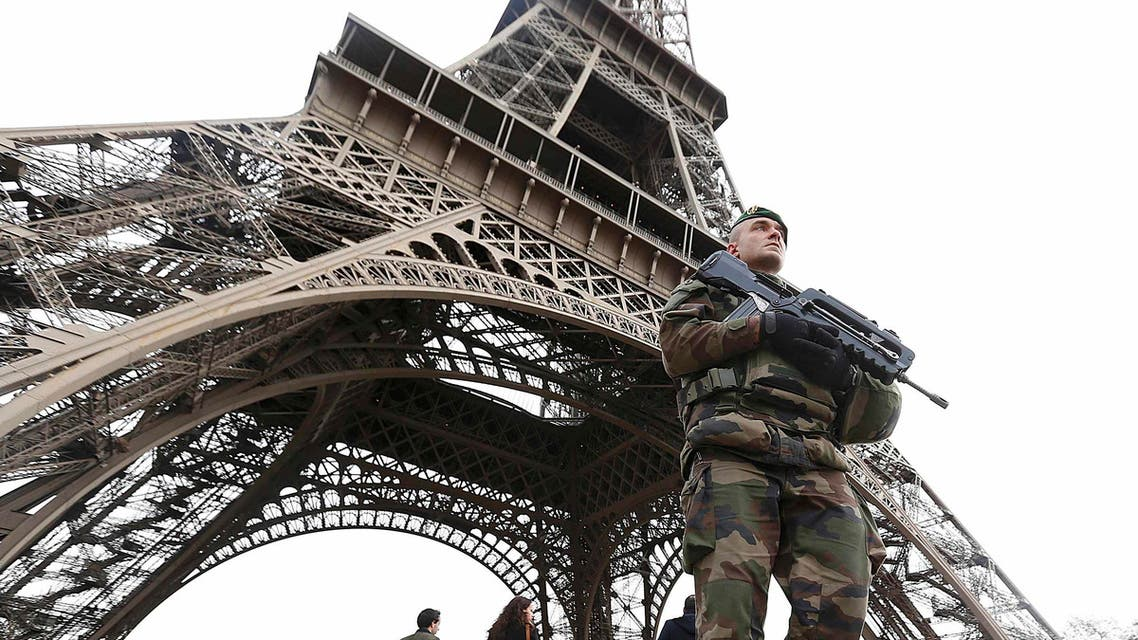 French military patrol near the Eiffel Tower the day after a series of deadly attacks in Paris , November 14, 2015. (Reuters)