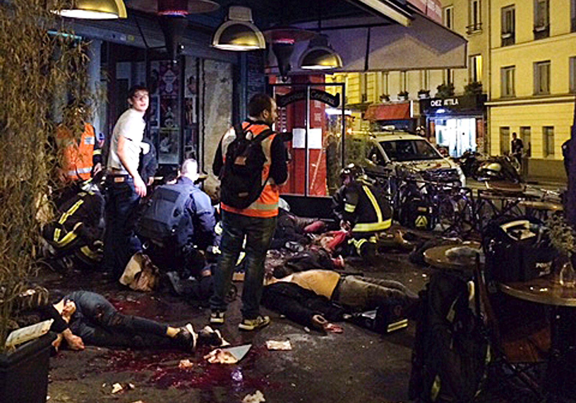 Victims of a shooting attack lay on the pavement outside La Belle Equipe restaurant in Paris Friday, Nov. 13, 2015. (AP)
