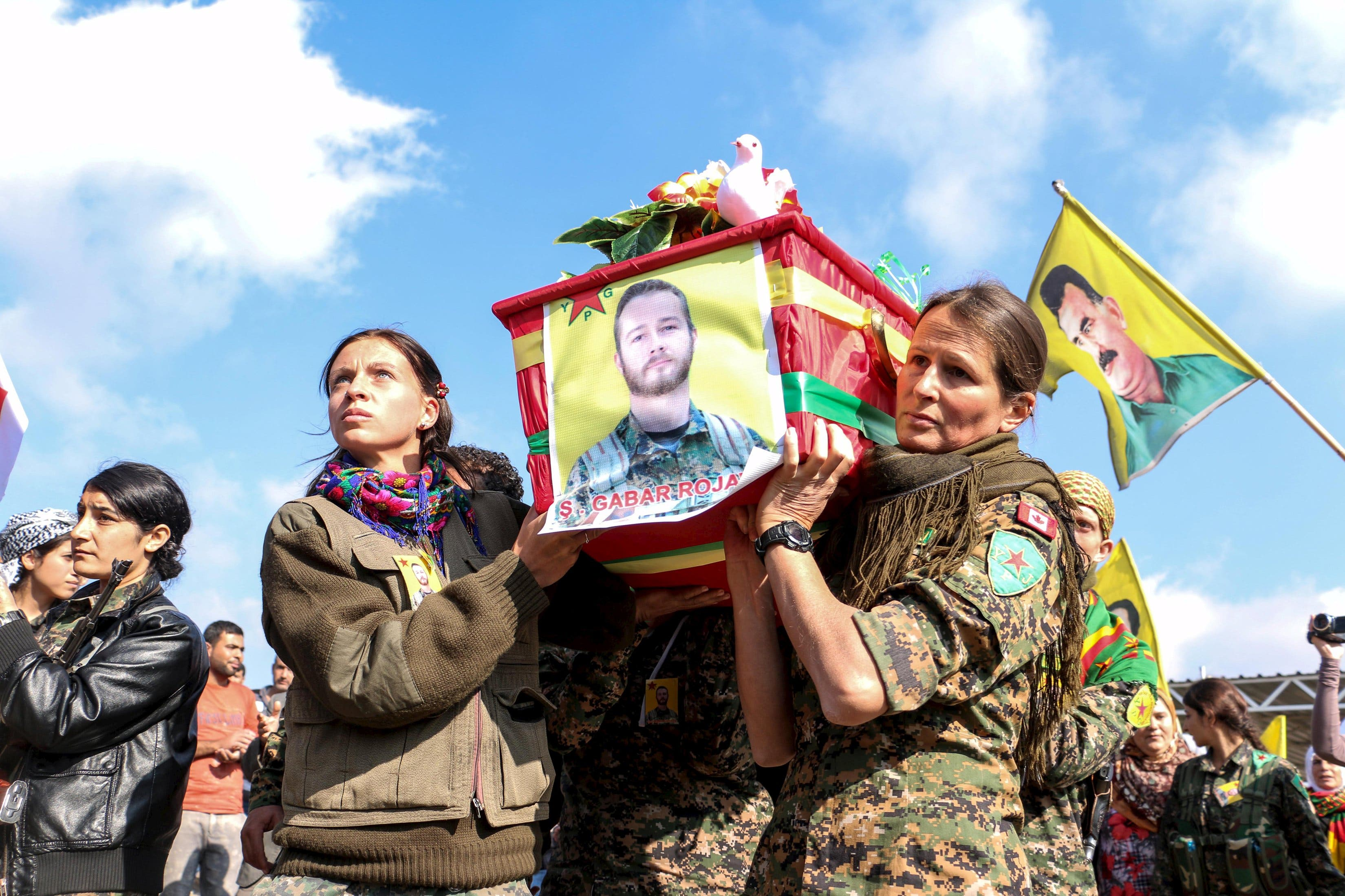 Kurdish People's Protection Units (YPG) fighters carry the coffin of fellow fighter John Robert Gallagher, a Canadian who died on November 4 in battle with Islamic State fighters, during his funeral in Hasaka, Syria November 12, 2015.