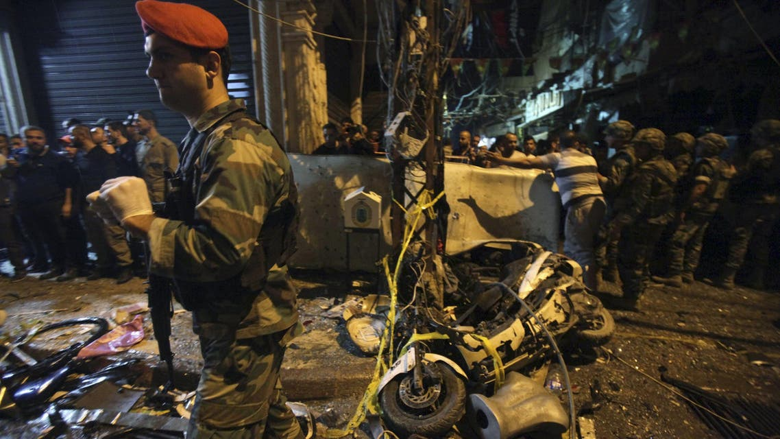 Residents and Lebanese army members inspect a damaged area caused by two explosions in Beirut's southern suburbs, Lebanon November 12, 2015. At least 37 people were killed and more than 181 wounded on Thursday in two suicide bomb blasts in a crowded district in Beirut's southern suburbs, a stronghold of the Shi'ite Muslim group Hezbollah. REUTERS/Khalil Hassan