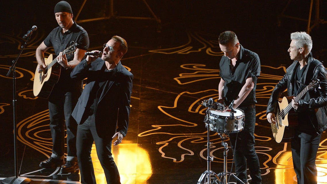 The Edge, from left, Bono, Larry Mullen, Jr. and Adam Clayton of U2 perform on stage during the Oscars at the Dolby Theatre on Sunday, March 2, 2014, in Los Angeles.
