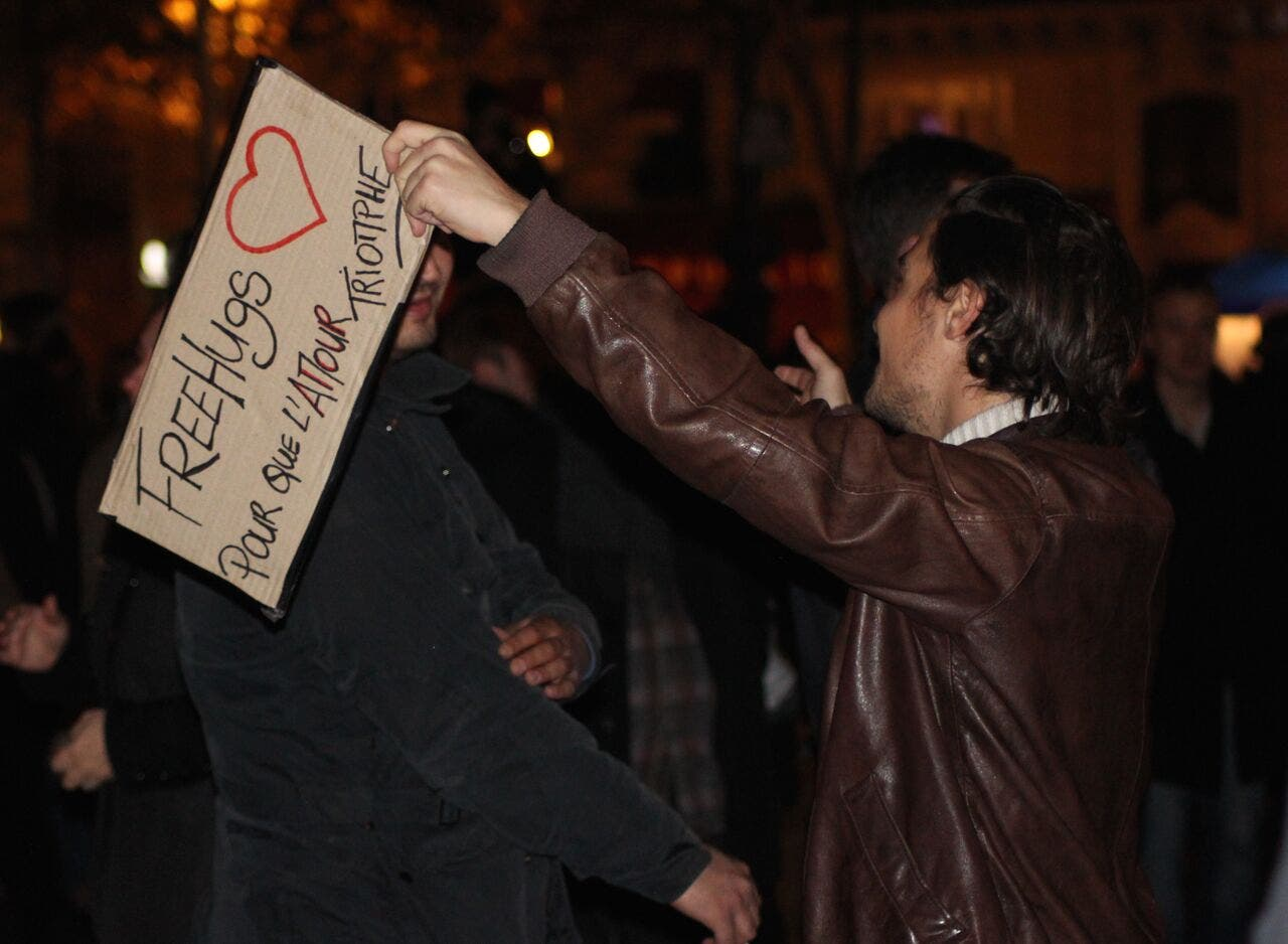 Free hugs at the Place de la Republique. (Asma Ajroudi/ Al Arabiya News)