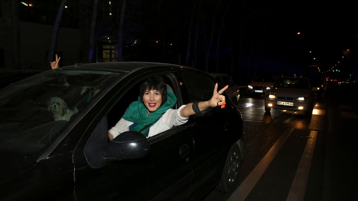 An Iranian woman flashes a victory sign from her car while celebrating on a street in northern Tehran, Iran, Thursday, April 2, 2015 (AP)