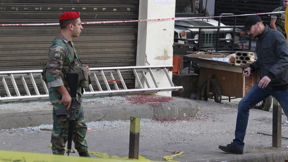 A Lebanese army soldier secures the area as blood stains are seen on the ground at the site of the two explosions that occured on Thursday in the southern suburbs of the Lebanese capital Beirut, November 13, 2015 REUTERS