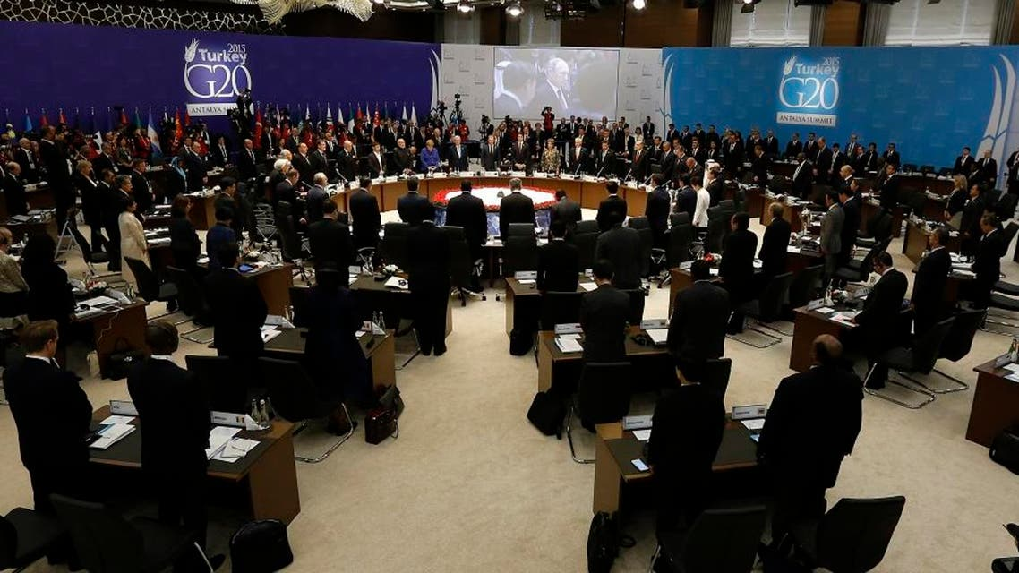 World leaders hold a minute of silence for the victims of Paris attacks prior to the opening session of the G-20 summit, in Antalya, Turkey, Sunday, Nov. 15, 2015. The 2015 G-20 Leaders Summit is held near the Turkish Mediterranean coastal city of Antalya on Nov. 15-16, 2015. (Anadolu Agency via AP, Pool)