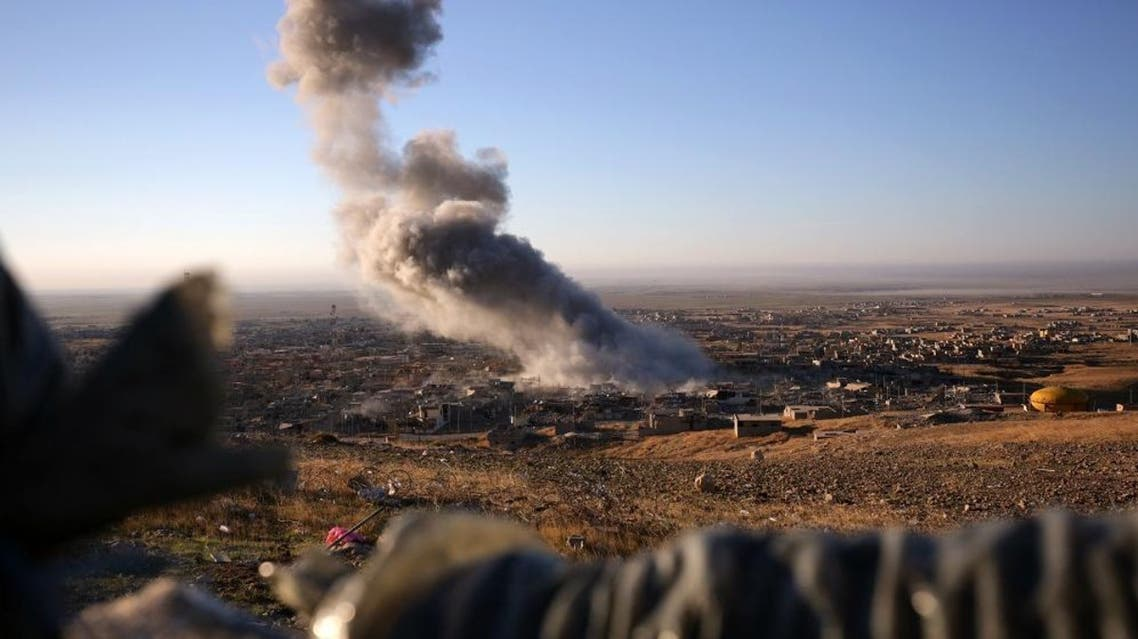 Smoke believed to be from an airstrike billows over the northern Iraqi town of Sinjar on Thursday, Nov. 12, 2015. AP