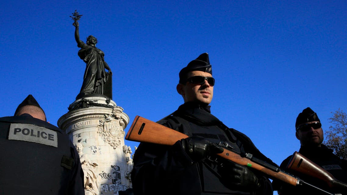 Police stand guard in Place de la Republique following the series of deadly attacks in Paris, November 15, 2015. (Reuters)