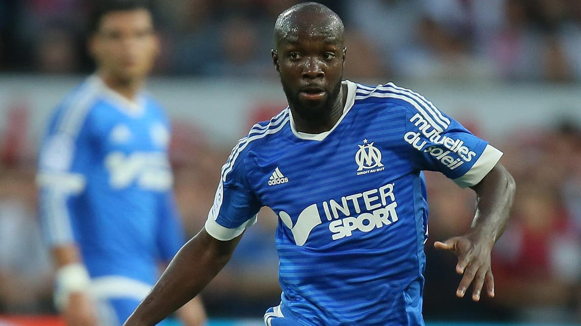 Marseille's french midfielder Lassana Diarra runs with the ball on the field during his French League One soccer match against Guingamp at the Roudourou stadium in Guingamp, western France, Friday, Aug. 28, 2015. (AP