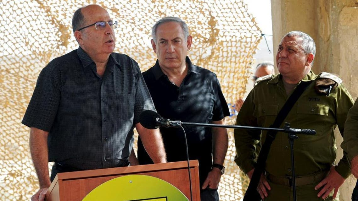 Israel's Defence Minister Moshe Yaalon (L) speaks next to Prime Minister Benjamin Netanyahu (C) and Army Chief of Staff Lieutenant-General Gadi Eisenkot (R). (File photo: Reuters)