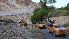 Libya groups clash with ISIS in eastern city