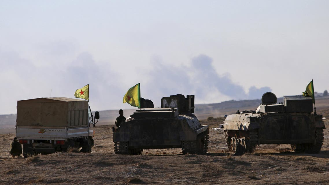 Fighters from the Democratic Forces of Syria stand near their infantry fighting vehicles around the al-Khatoniyah lake area after they took control of it from Islamic State militants, near al Houl town in Hasaka province, Syria November 14, 2015. REUTERS