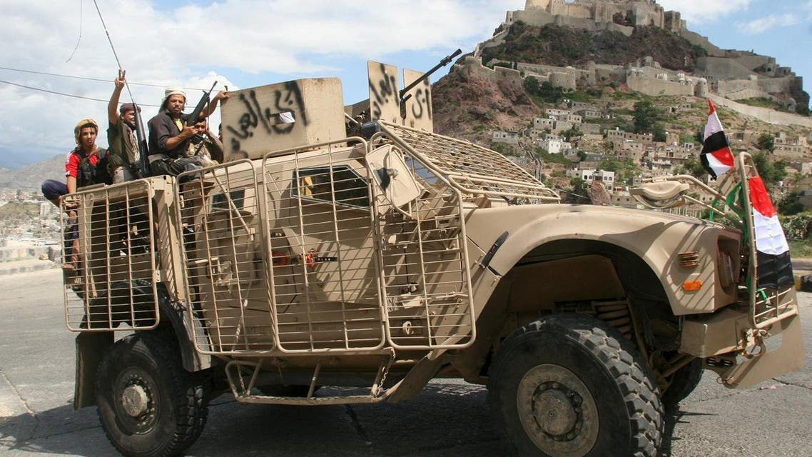 Fighters loyal to Yemen's government celebrate after they received three armoured personnel carriers from the United Arab Emirates in the southwestern city of Taez. (File photo: Reuters)