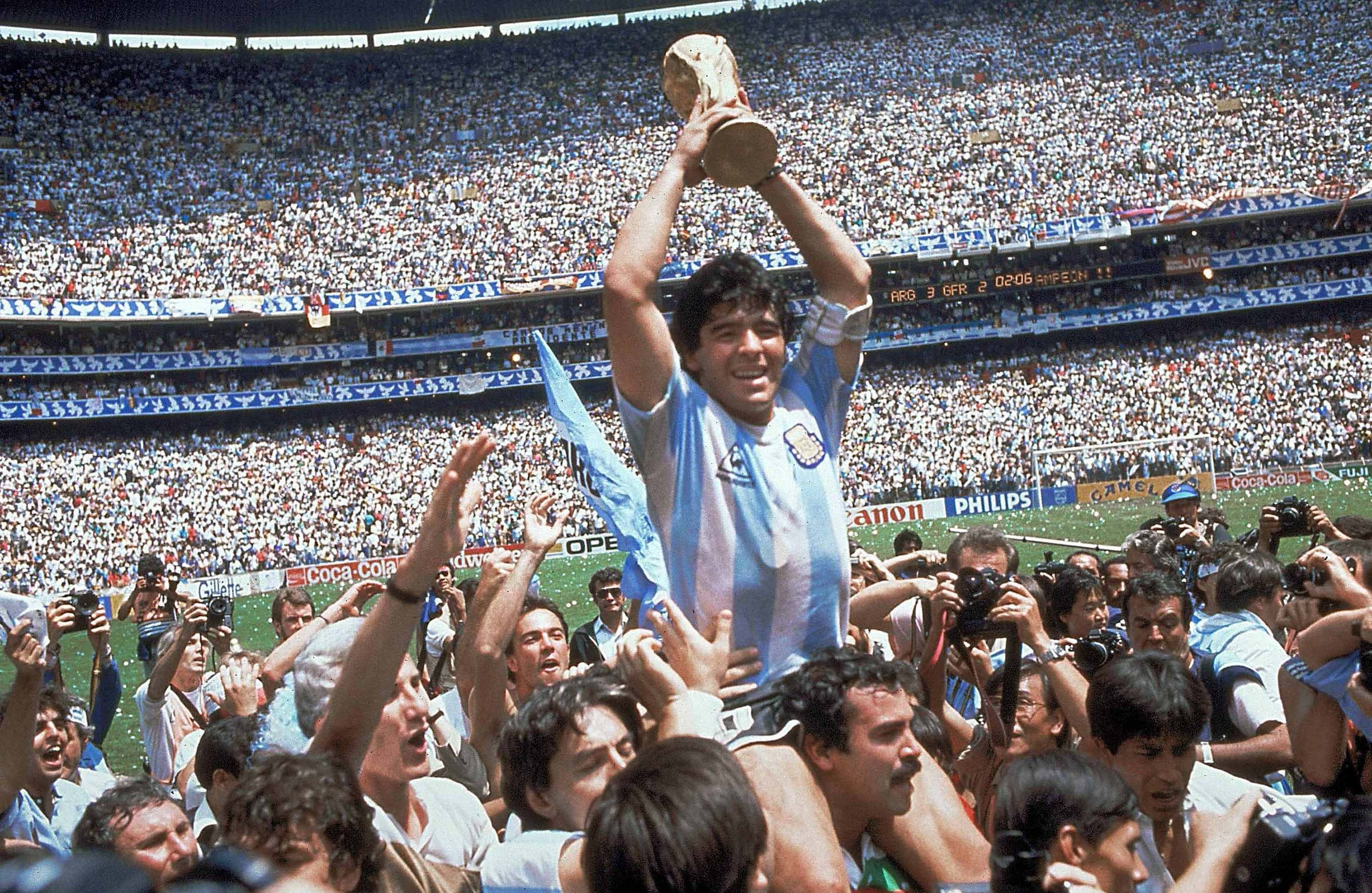 In this June 29, 1986, file photo, Diego Maradona, holds up the trophy, after Argentina beat West Germany 3-2 in their World Cup soccer final match, at the Atzeca Stadium, in Mexico City.