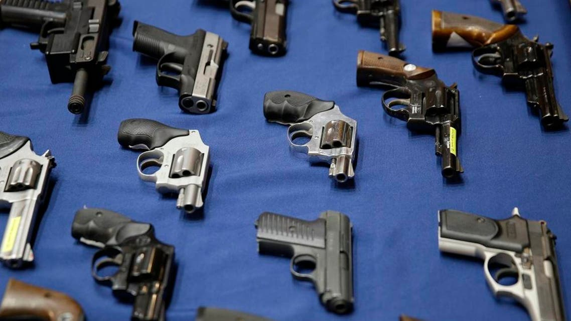 Guns seized by the police are displayed during a news conference in New York, Tuesday, Oct. 27, 2015. (AP Photo/Seth Wenig)