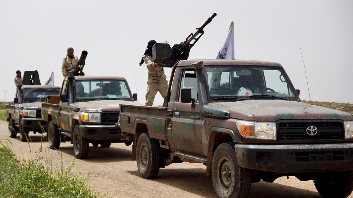 Rebel fighters move in a convoy as they head towards the town of Busra al-Harir in Deraa province April 20, 2015. (File photo: Reuters)