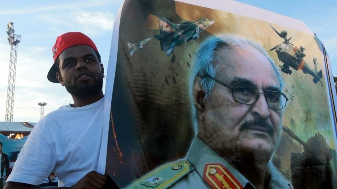 A man holds a picture of General Khalifa Haftar during a demonstration in support of the Libyan army. (File photo: Reuters)