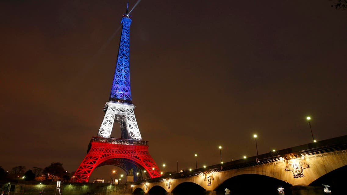 The Eiffel Tower is lit with the blue, white and red colours of the French flag in Paris, France, November 16, 2015 REUTERS
