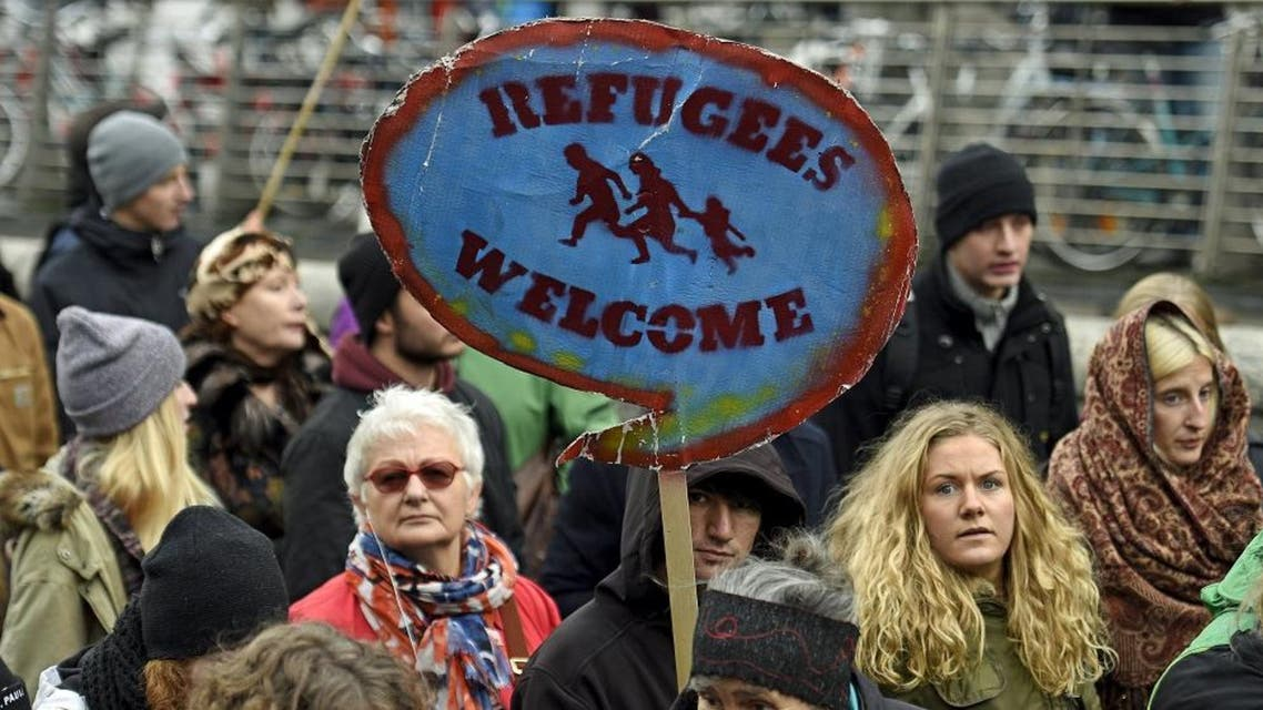A protest holds up a sign during a pro-refugee demonstration in downtown Hamburg, Germany November 14, 2015. (File photo: Reuters)