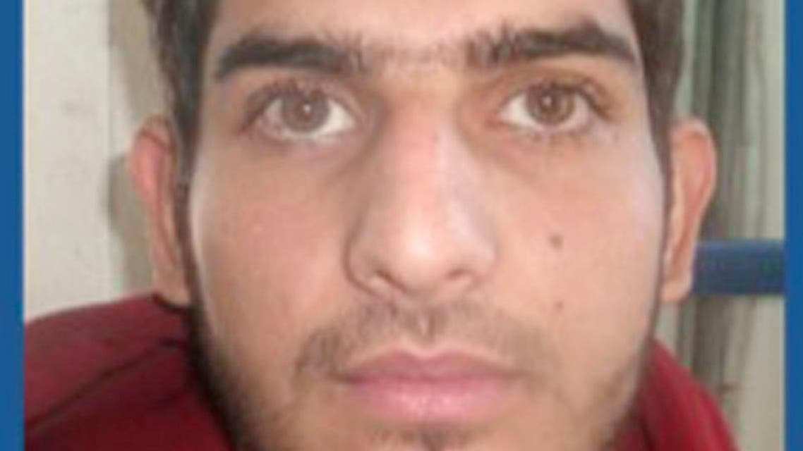 This undated photo released late Sunday, Nov. 15, 2015, by Greece's migration policy ministry shows a registration photo from a document issued to 25-year old Ahmad Almohammad, holder of a Syrian passport found near a dead assailant in the scene of a Paris attack Friday. The document was issued on Sunday, Oct. 4 by authorities on the Greek island of Leros, where the man arrived a day earlier on a frail boat carrying migrants over from Turkey. It protects him from deportation for six months, and is the same documentation routinely issued to thousands of newly-arrived migrants. (Greek Migration Ministry via AP)