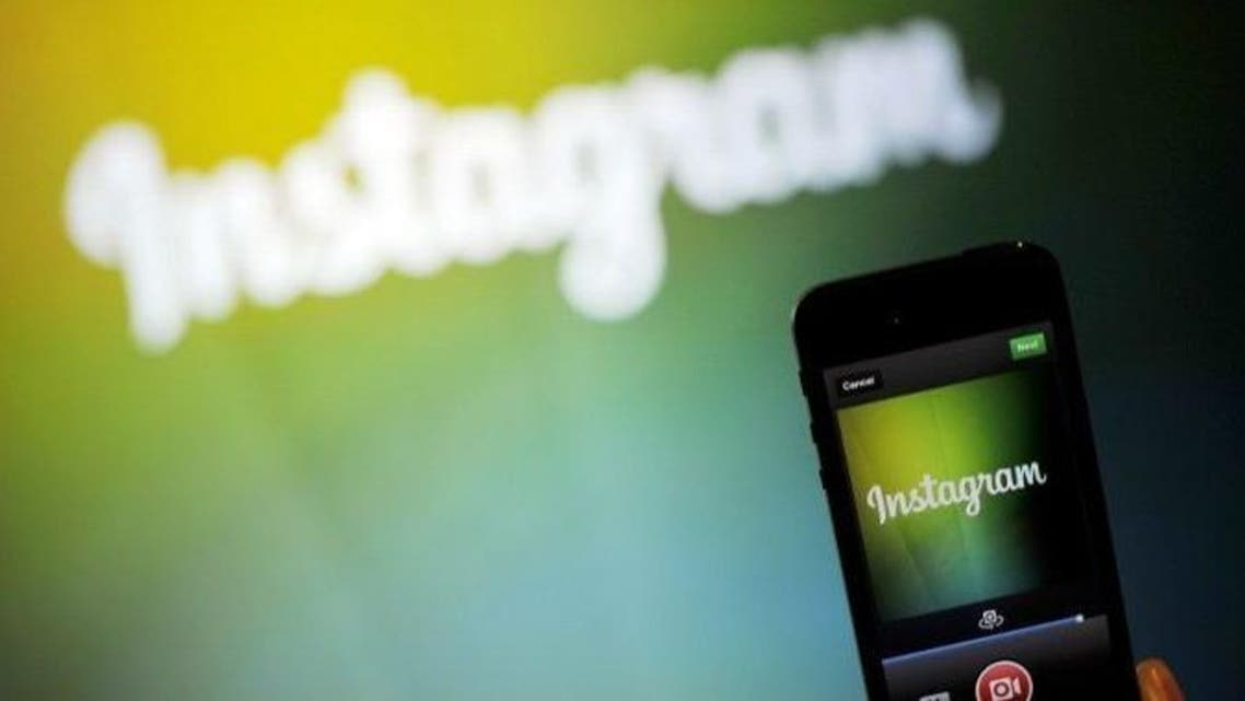 An Instagram employee displays Instagram's new video function during a media event in Menlo Park, California on June 20, 2013. (Photo: AFP/Josh EDELSON)