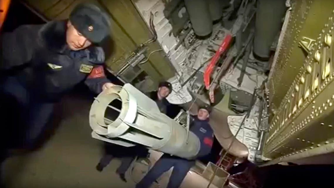 In this photo made from the footage taken from Russian Defense Ministry official web site on Tuesday, Nov. 17, 2015, Russian air force personnel load bombs onto a Tu-22 bomber in preparation for a bombing mission against targets in Syria. Russia's defense minister said its warplanes have fired cruise missiles on militant positions in Syria's Idlib and Aleppo provinces. The Islamic State group has positions in Aleppo province; Idlib has the presence of the Nusra militant group. (AP Photo/ Russian Defense Ministry Press Service)