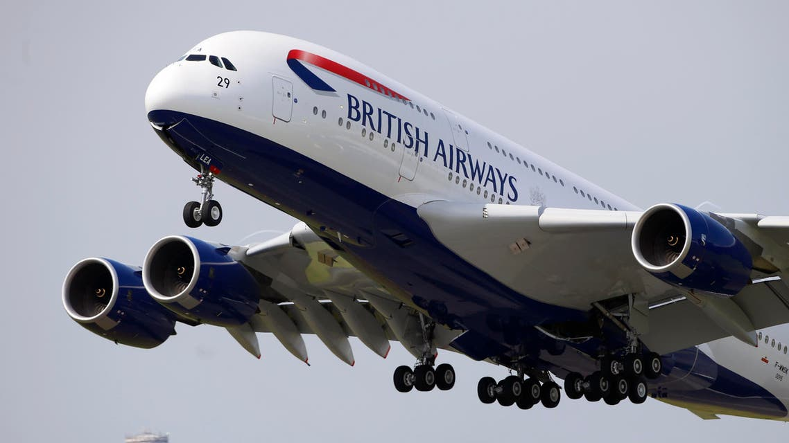 A British Airways Airbus A380 aircraft performs its demonstration flight during the first day of the 50th Paris Air Show at Le Bourget airport, north of Paris, Monday, June 17, 2013. (AP Photo/Francois Mori)