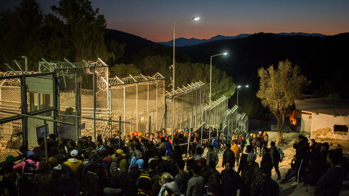 Refugees and migrants wait to enter a registration center in Moria village on the northeastern Greek island of Lesbos,, Tuesday, Nov. 17, 2015. European leaders pressed ahead with efforts to discourage people from heading to Europe to find work and kept seeking ways to send back home thousands who don't qualify for asylum. (AP Photo/Santi Palacios)