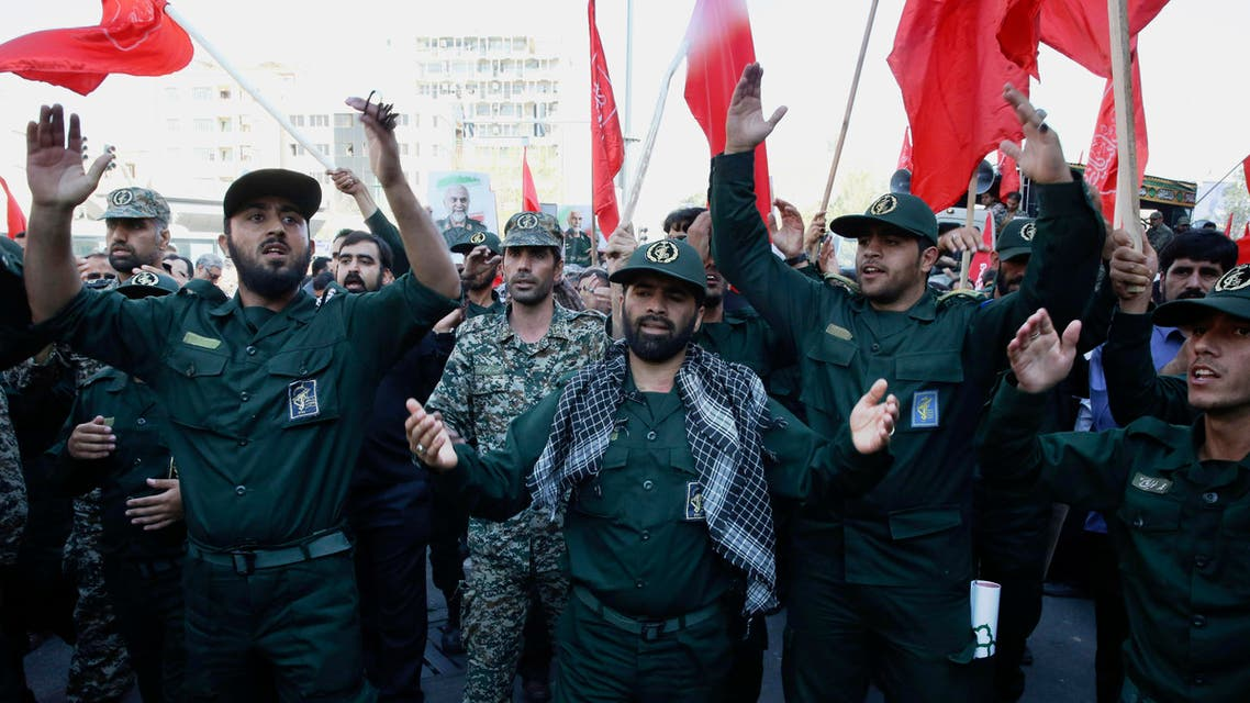 A group of Iranian Revolutionary Guard members mourn during the funeral ceremony of Gen. Hossein Hamedani in Tehran, Iran, Sunday, Oct. 11, 2015. Hamedani, a senior commander of the Guard, was killed by Islamic State extremists last week near the Syrian city of Aleppo, according to a state TV report. (AP Photo/Vahid Salemi)