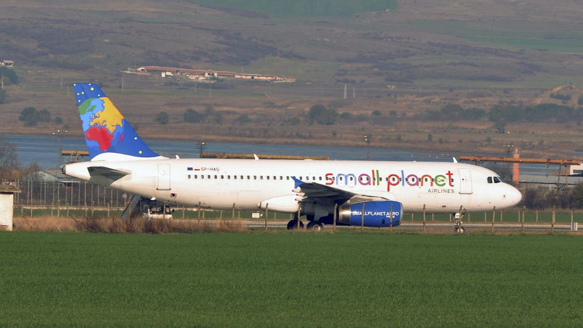 An Airbus A320-232, operated by charter firm Small Planet Airlines Poland, is seen in Burgas airport after it made an emergency landing following a bomb threat en route from Warsaw to Egypt, Bulgaria November 19, 2015. REUTERS/Bulphoto Agency THIS IMAGE HAS BEEN SUPPLIED BY A THIRD PARTY. IT IS DISTRIBUTED, EXACTLY AS RECEIVED BY REUTERS, AS A SERVICE TO CLIENTS. BULGARIA OUT. NO COMMERCIAL OR EDITORIAL SALES IN BULGARIA. EDITORIAL USE ONLY. NO RESALES. NO ARCHIVE.