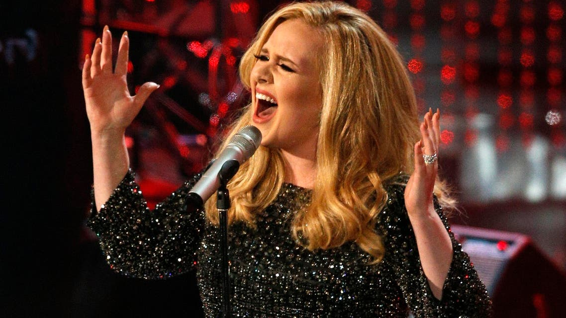 """British singer Adele performs the song """"Skyfall"""" from the film """"Skyfall,"""" at the 85th Academy Awards in Hollywood, California, in this file photo taken February 24, 2013."""