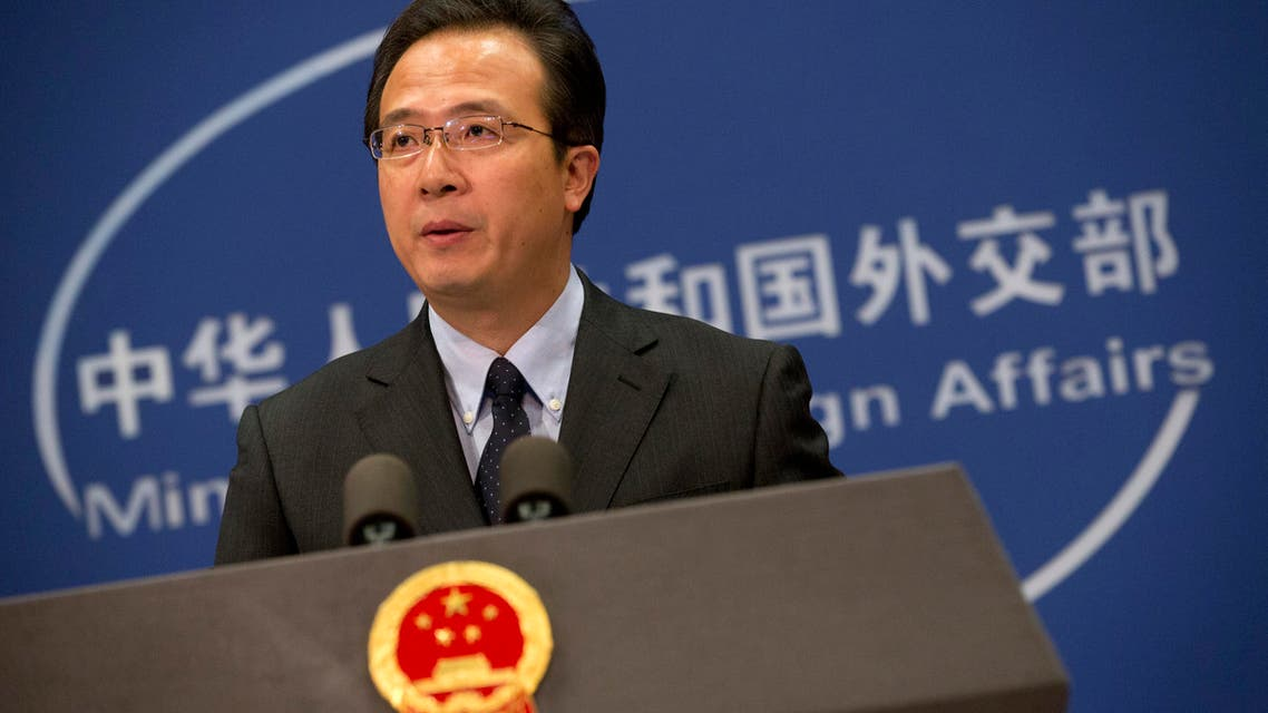 Chinese foreign ministry spokesman Hong Lei speaks during a daily briefing at the Ministry of Foreign Affairs office in Beijing Thursday, Nov. 19, 2015.