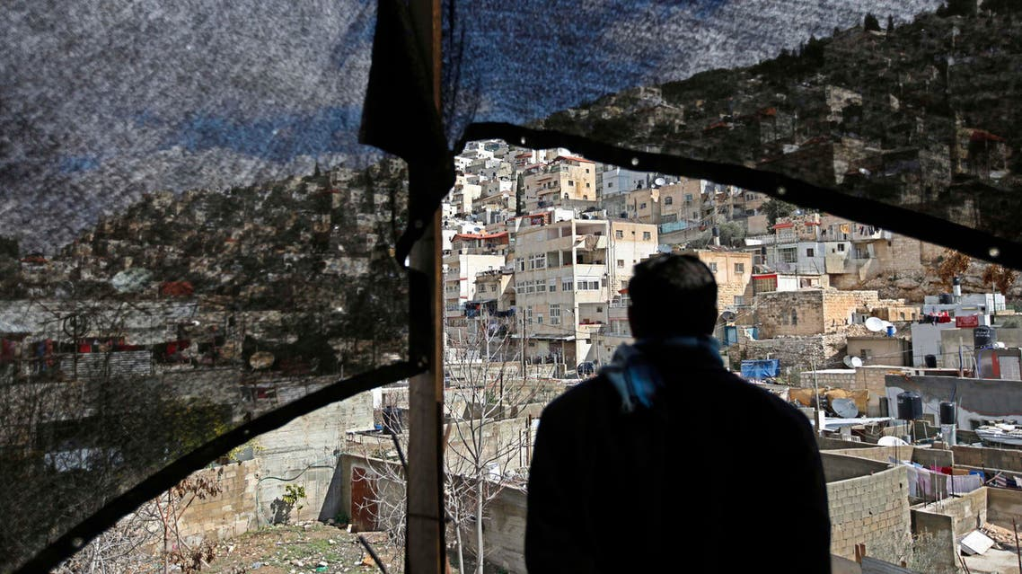A Palestinian man looks out over the neighborhood of Silwan in Jerusalem, Monday, Feb. 23, 2009. Just outside the Old City walls in east Jerusalem and near the city's holiest shrines for Jews and Muslims, the ramshackle Arab neighborhood of Silwan stands atop a site Israelis call the City of David, named for the Biblical monarch who ruled a Jewish kingdom from the spot 3,000 years ago. The Israeli government has designated the area an archaeological park whose expansion the Arab homes limit. Arab residents say they owned the land before Israel occupied east Jerusalem in 1967 and consider the demolition orders an effort to diminish their presence in the capital of a hoped-for Palestinian state. (AP Photo/Tara Todras-Whitehill)