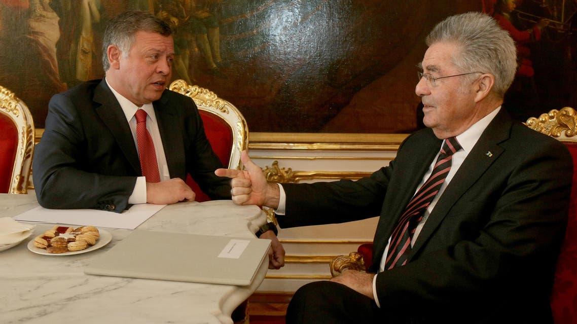 Austrian President Heinz Fischer, right, talks with Jordan's King Abdullah II, left, at the Hofburg palace Vienna, Austria, Wednesday, Nov. 18, 2015.