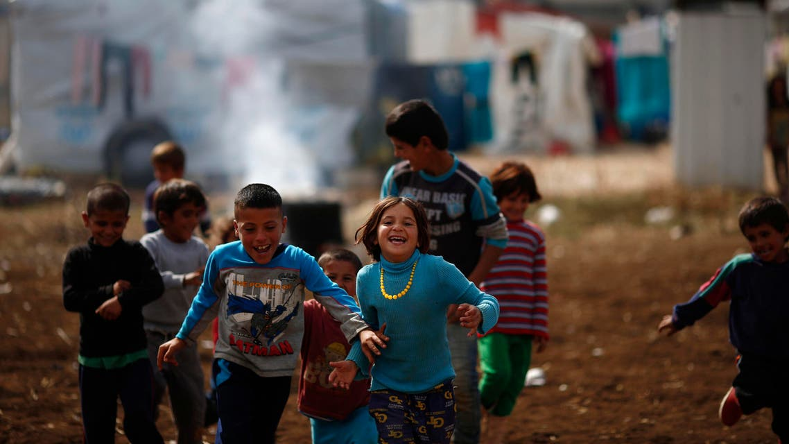 Syrian refugee boys play at a refugee camp in the town of Hosh Hareem, in the Bekaa valley, east Lebanon, Wednesday, Oct. 28, 2015. The United Nations said Tuesday the worsening conflict in Syria has left 13.5 million people in need of aid and some form of protection, including more than six million children. (AP Photo/Hassan Ammar)