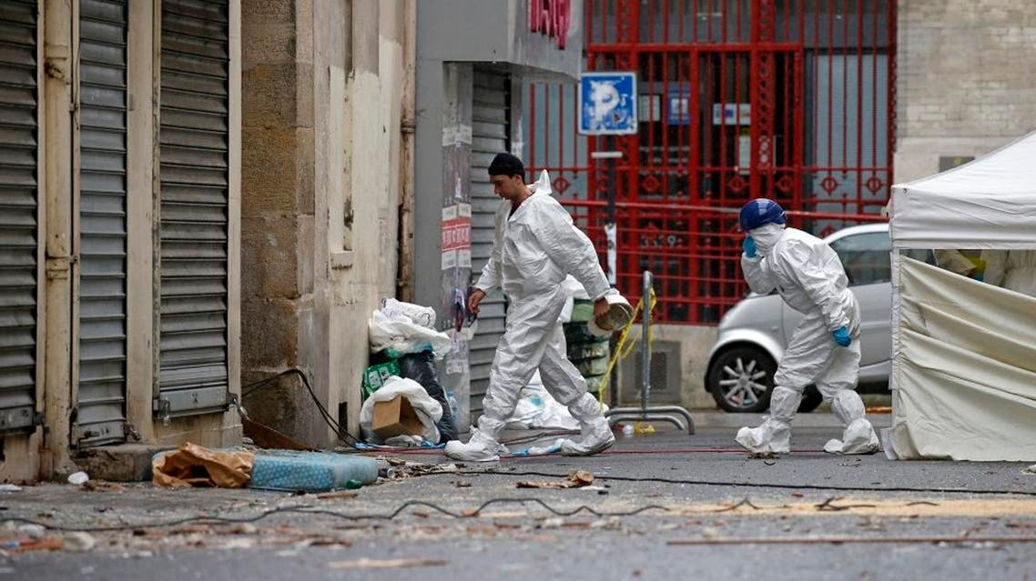 Forensics of the French police are at work outside a building in Saint-Denis, near Paris. (Reuters)