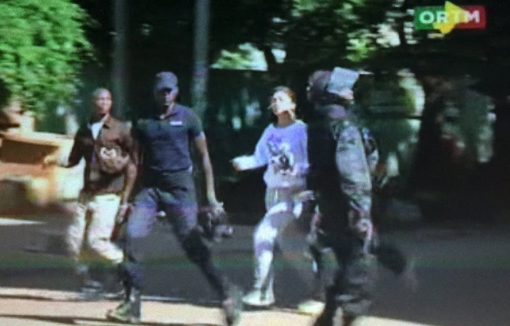 Still image from video show a hostage rushed out from the Radisson hotel in Bamako, Mali, November 20, 2015. (Reuters)