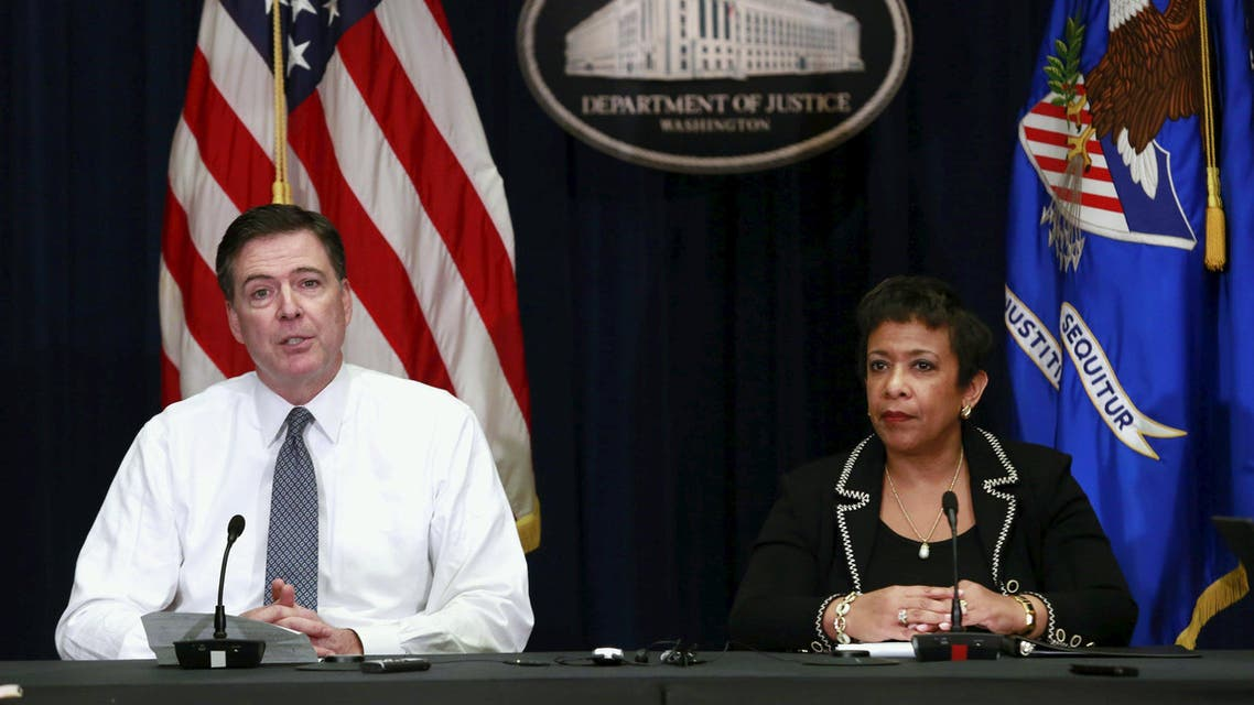 U.S. Attorney General Loretta Lynch (R) and FBI Director James Comey hold a media briefing at the Justice Department in Washington November 19, 2015.