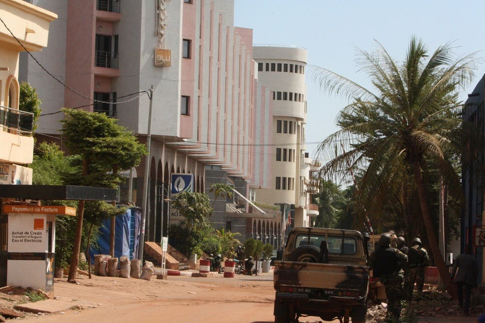The Radisson Blu hotel, left, that was stormed by gunmen during an attack on the hotel in Bamako, Mali, Friday, Nov. 20, 2015. Islamic extremists armed with guns and throwing grenades stormed the Radisson Blu hotel in Mali's capital Friday morning, killing at least three people and initially taking numerous hostages, authorities said. (AP Photo/Harouna Traore)
