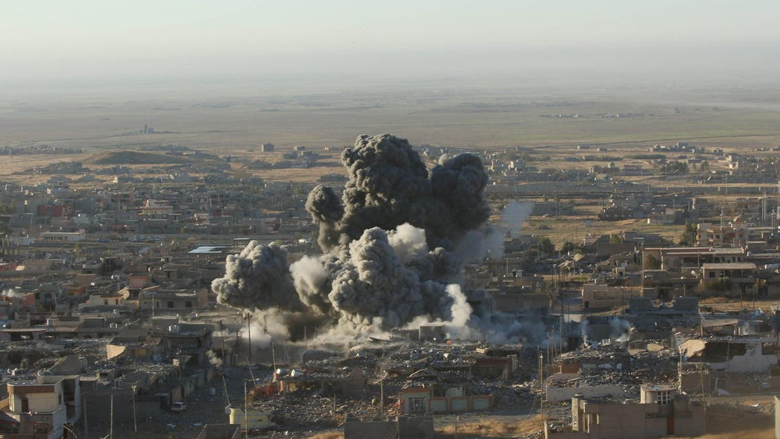 Smoke rises from the site of U.S.-led air strikes against ISIS in the town of Sinjar, November 12, 2015. (Reuters)