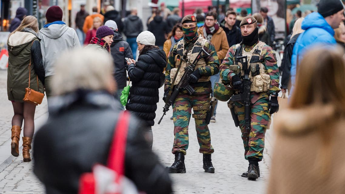 Soldiers from the Belgian army patrol in the picturesque Grand Place in Brussels on Friday, Nov. 20, 2015.