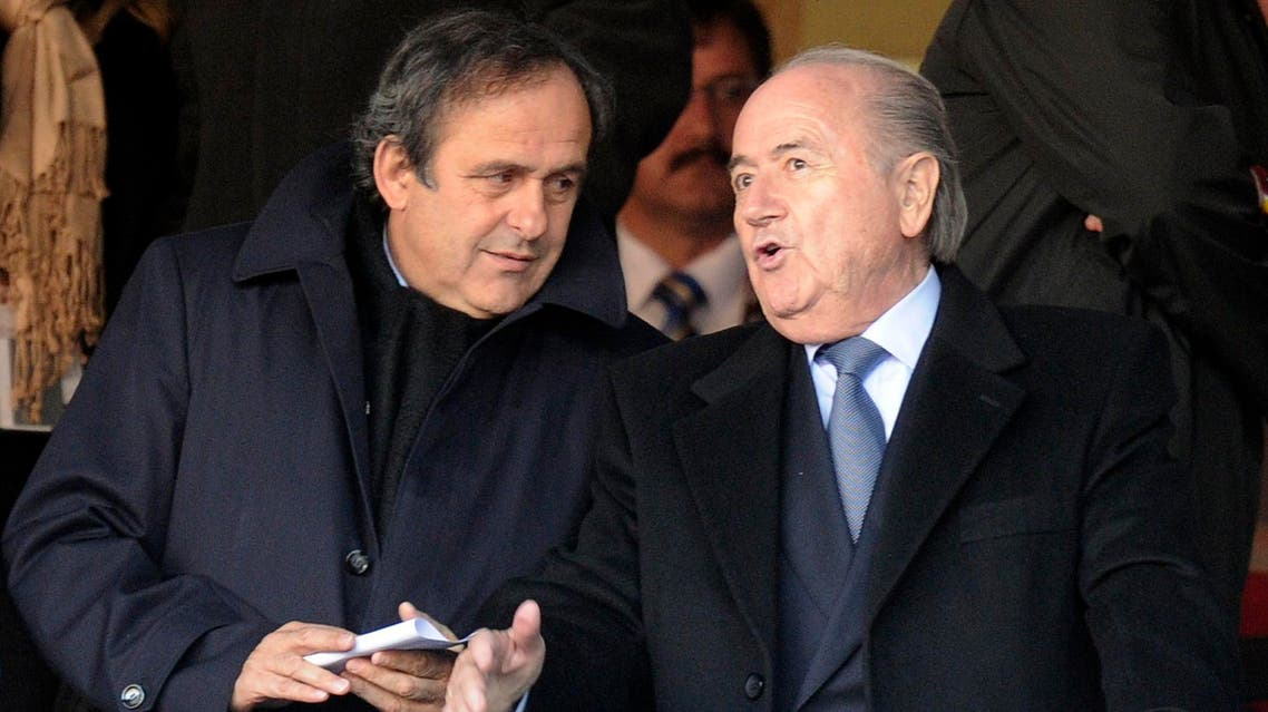 UEFA president Michel Platini, left, talks with FIFA president Sepp Blatter, right, in this file photo dated Friday, June 18, 2010,