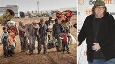 9/11 filmmaker Michael Moore opens home to Syrian refugees