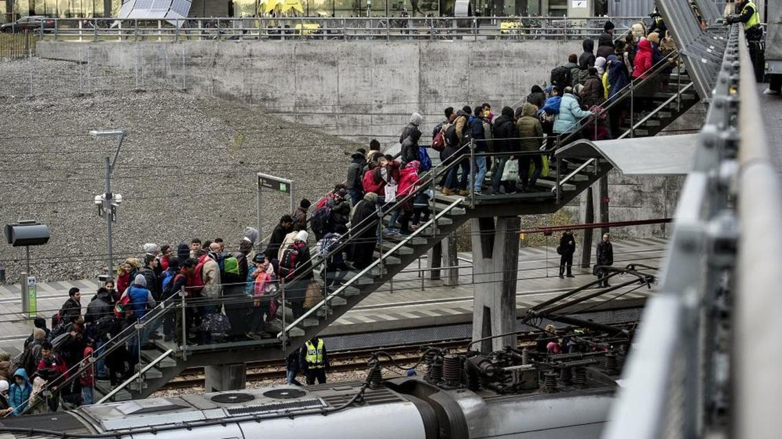 Police organize the line of refugees at on the stairway leading up from the trains arriving from Denmark at the Hyllie train station outside Malmo, Sweden, November 19, 2015. Sweden, a favourite destination for refugees flooding into Europe, can no longer house all those arriving and many will have to find their own accommodation, the country's migration agency said on Thursday. Sweden has already imposed temporary border controls in response to the record influx of refugees, while authorities plan to shelter thousands of people in heated tents as well as venues such as ski resorts and a theme park. Picture taken November 19, 2015. REUTERS/Johan Nilsson/TT News Agency