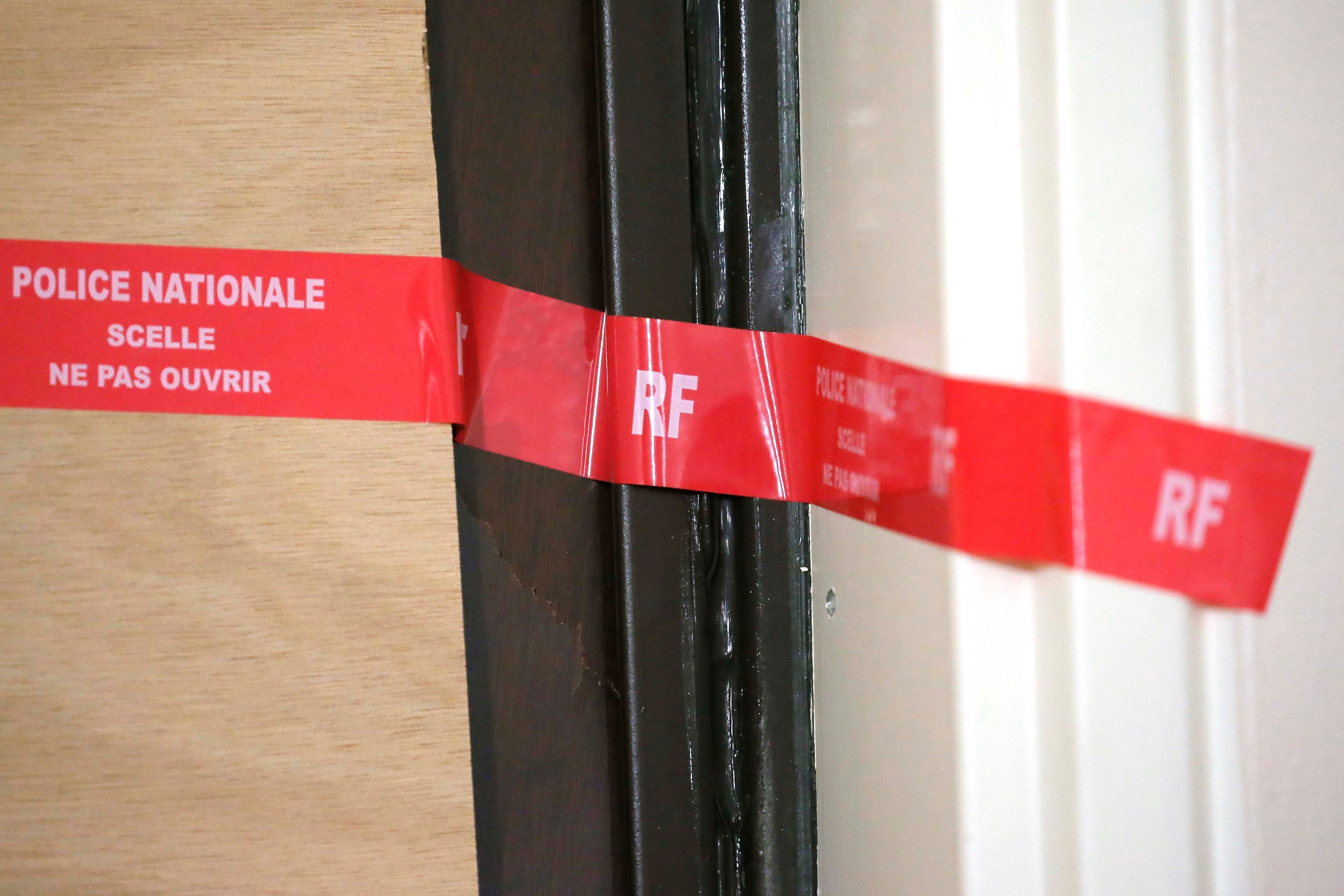 A view shows the front door which has been blocked and sealed by police at the apartment where Samy Amimour, one of the attackers identified by the police, grew up in the Parisian suburb of Drancy, France, November 17, 2015.