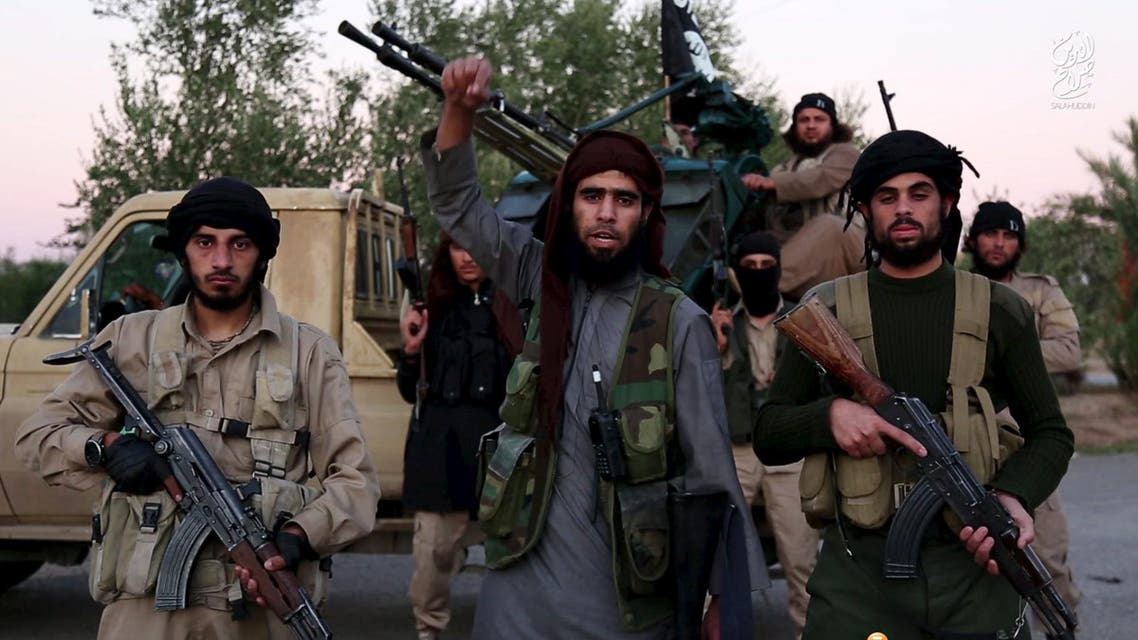 Image taken from ISIs video footage shows a man identified in the subtitiles as Al Karar the Iraqi gesturing as he speaks. (Reuters)