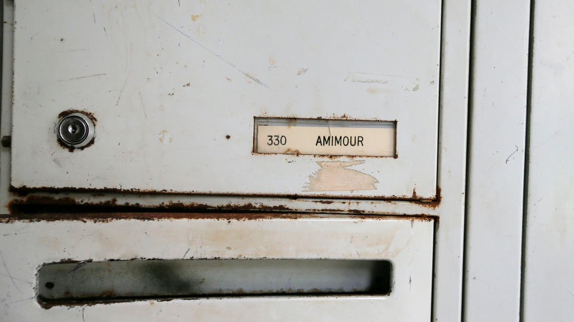"""A name on letter box reading """"Amimour"""" is seen at the entrance of an apartment building where Samy Amimour, one of the attackers identified by the police, grew up in the Parisian suburb of Drancy, France, November 17, 2015."""